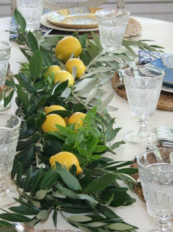 centrotavola limoni e foglie ulivo
