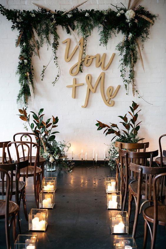 allestimento matrimonio con candele e foglie