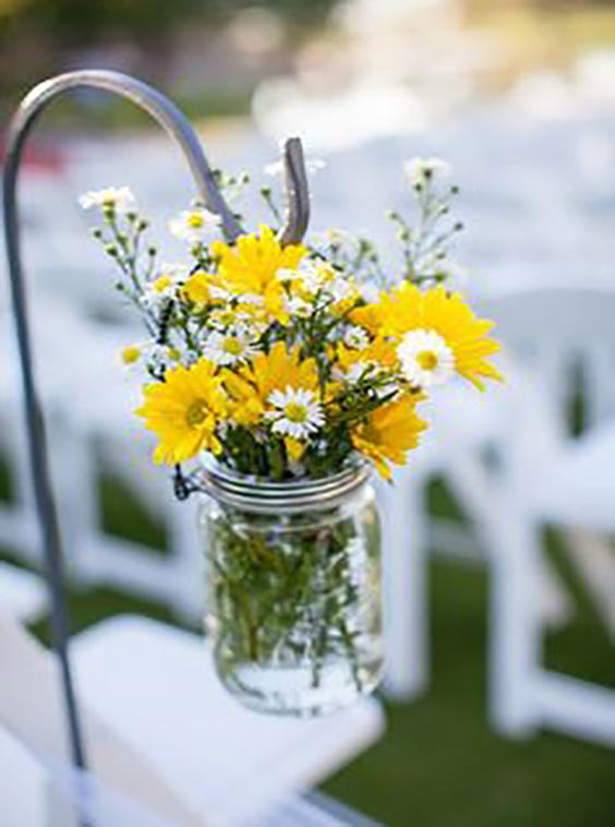decorazione matrimonio margherite gialle e bianche