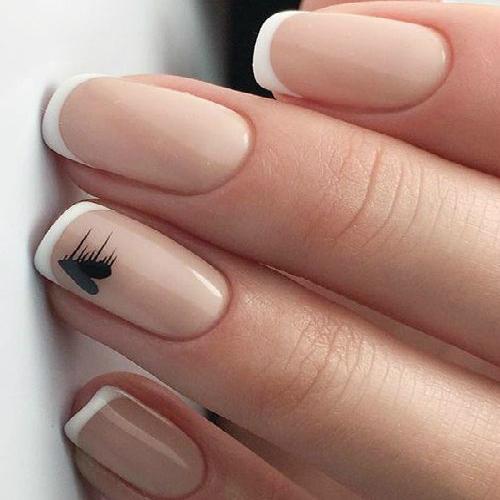 french manicure con cuoricino nero su anulare ispirazione wedding unghie sposa